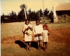 Mary Wanjiru and her sister Lucy, the baby on her back, and a friend. Photo credit: c. Jane H. Johann, Kiriko, Kenya, East Africa, 1976
