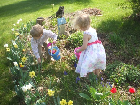 Grandchildren, Ayden & Nadia, egg-hunting in the yard.